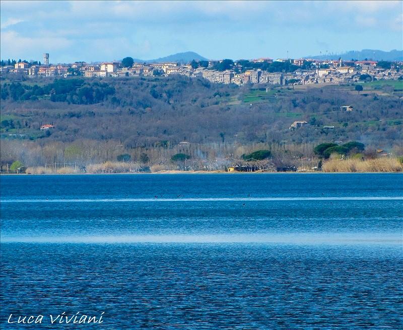 Grotte di Castro e il lago di Bolsena